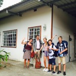 Family of five in front of a Hostel