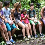 Group listening to tour guide in jungle setting