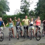 Group on bikes in front of forested park setting