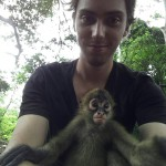 Volunteer holding baby monkey