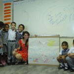 Foreign teacher in classroom with local kids