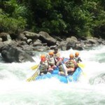 Blue raft floating down the river with clients