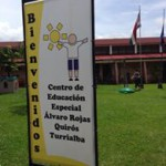 "Sign that says ""Bienvenidos"" and name of the local organization"