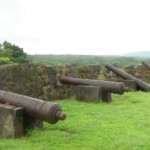 Four canons of the fortress with ocean in the back