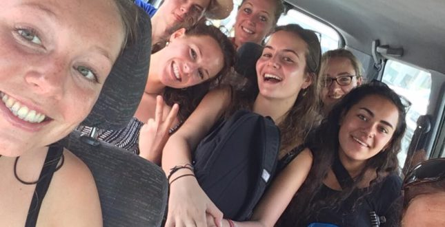 Happy students in the car with the Travelling Classroom.