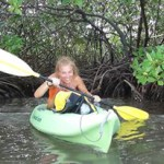 Happy girl in a green kayak