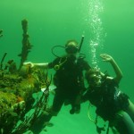Scuba divers with sunken ship