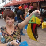 Tourist showing a mask in the form of a tucan