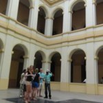 Students with guide in historical building in Panama City