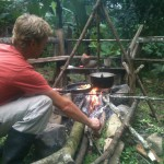 Guy making food on open fire