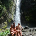 Girls posing in front of beautiful waterfall