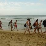 Group walking down beach