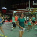 Happy group of students working out with zumba