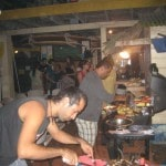 Two persons doing barbecue in party