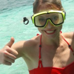 Smiling girl in snorkel gear
