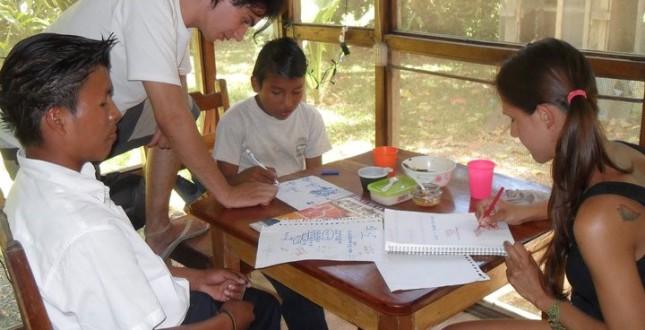 Volunteer at work with kids at El Puente.
