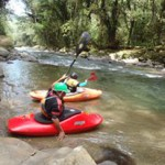 Two persons in kayak in a beautiful river