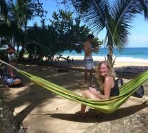 Student in hammock in Bluff Beach
