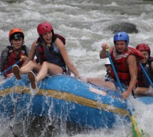 Students having fun rafting in Turrialba