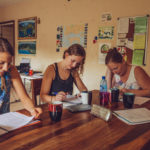 Four girls studying at a table