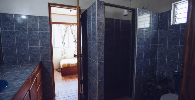Bathroom and peek to a hostel room Boquete hostel