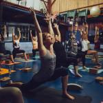 Peole doing sun salutations in a yoga class