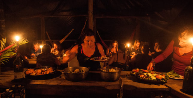 Clients at night in Jungle kitchen Gekui Camp
