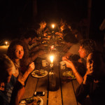 People eating dinner with candle light in Pacuare River