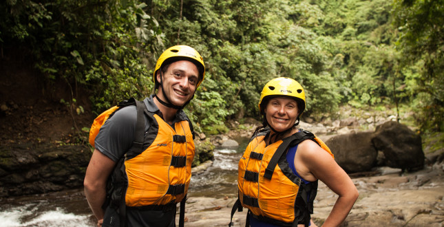 Happy rafters in front of a creek of the Pacuare River