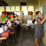 Foreign girl writing on a blackboard in Costa Rican Classroom
