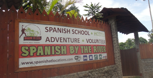 Road sign in front of the school in Turrialba