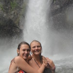Girls in front of cascading waterfall