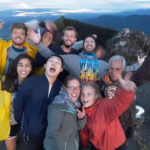 Happy students on top of a volcano
